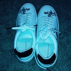 White shoes with floral designs.